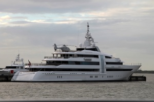 The biggest, most garish, expensive, and gaudiest yacht in the marina - an its on-board helicopter.