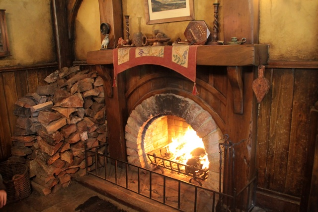Acozy hearth to warm your furry little feetses inside the Green Dragon Inn